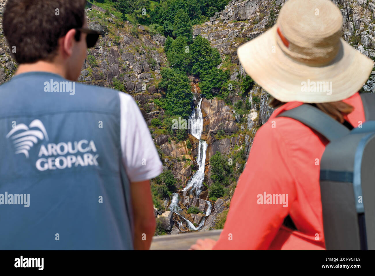 Arouca Geopark Guide and tourist looking to waterfall from Passadicos do Paiva - Stock Image