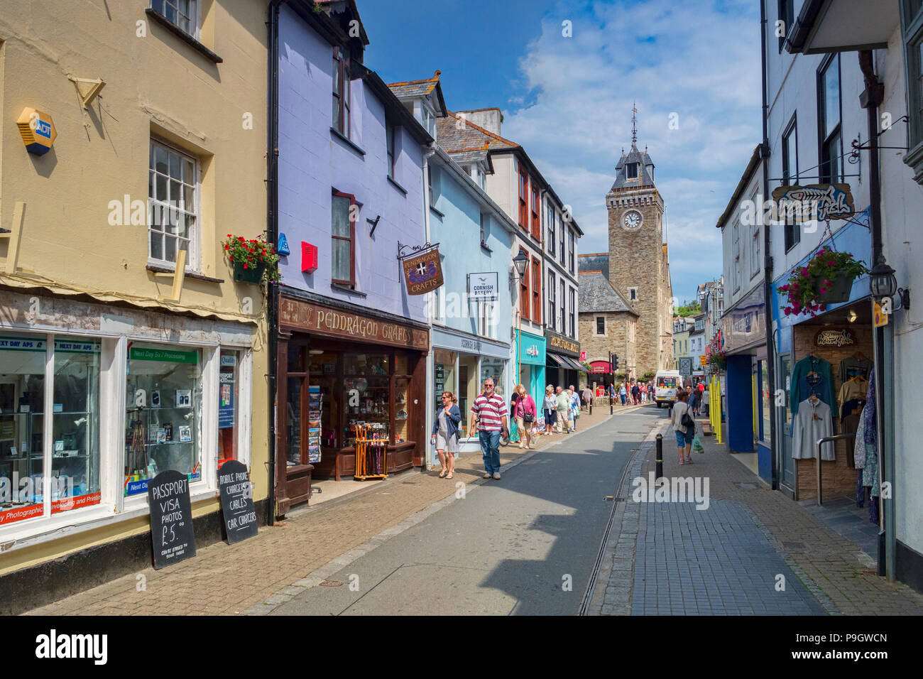 6 June 2018: Looe, Cornwall, UK - Shopping in Fore Street on a warm spring day. - Stock Image