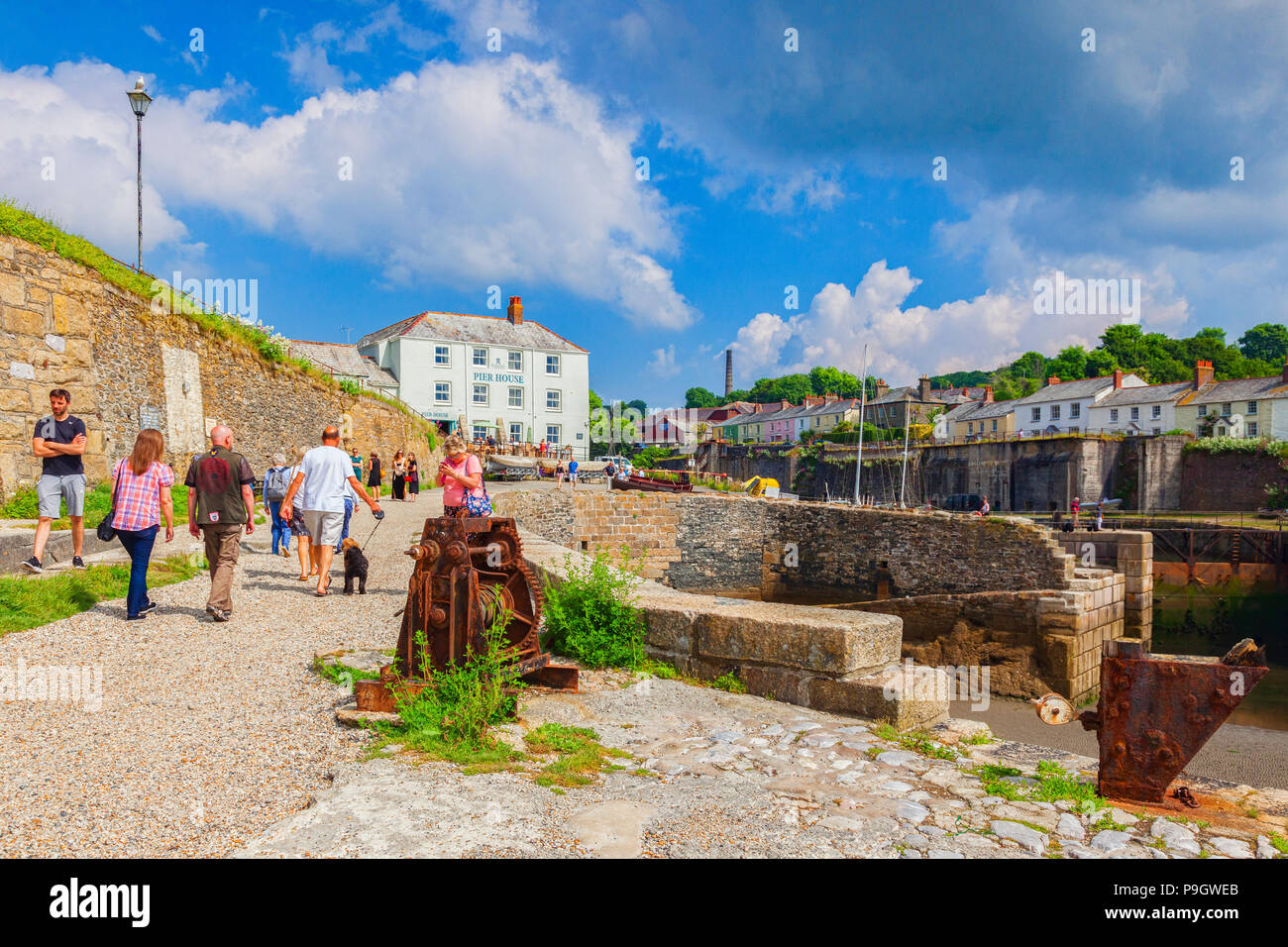 11 June 2018: Charlestown, Cornwall, UK - Visitors at Charlestown, an unspoiled example of a Georgian working port, it was built betweel 1791 and 1801 - Stock Image