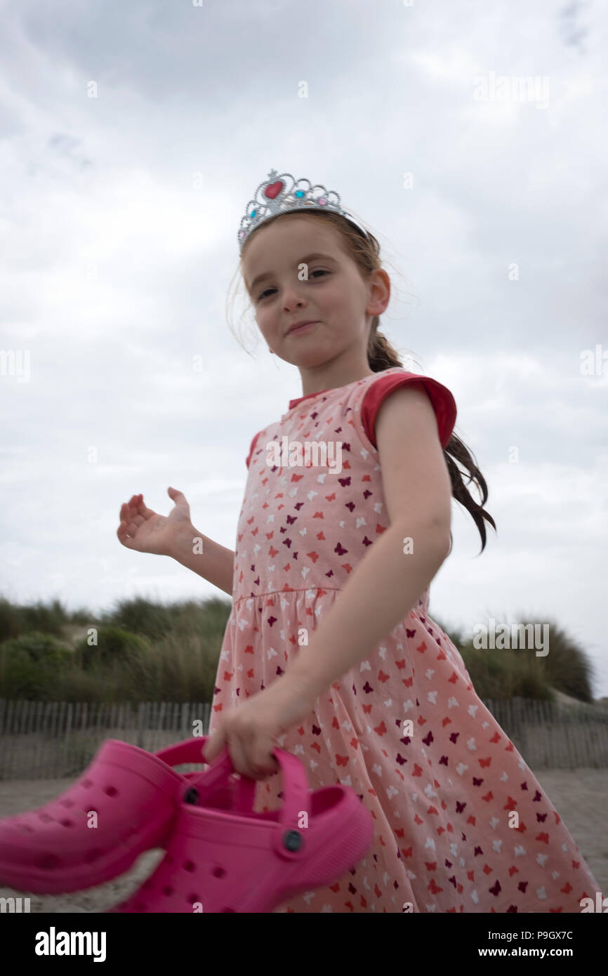 Fun Shot Of A Walking 4 Year Old Girl With Red Long Hair Wearing A