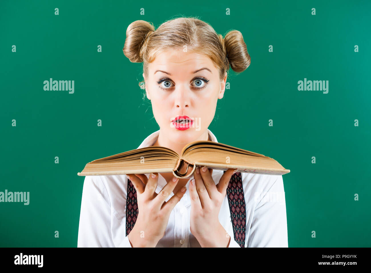 Wisdom comes from book - Stock Image