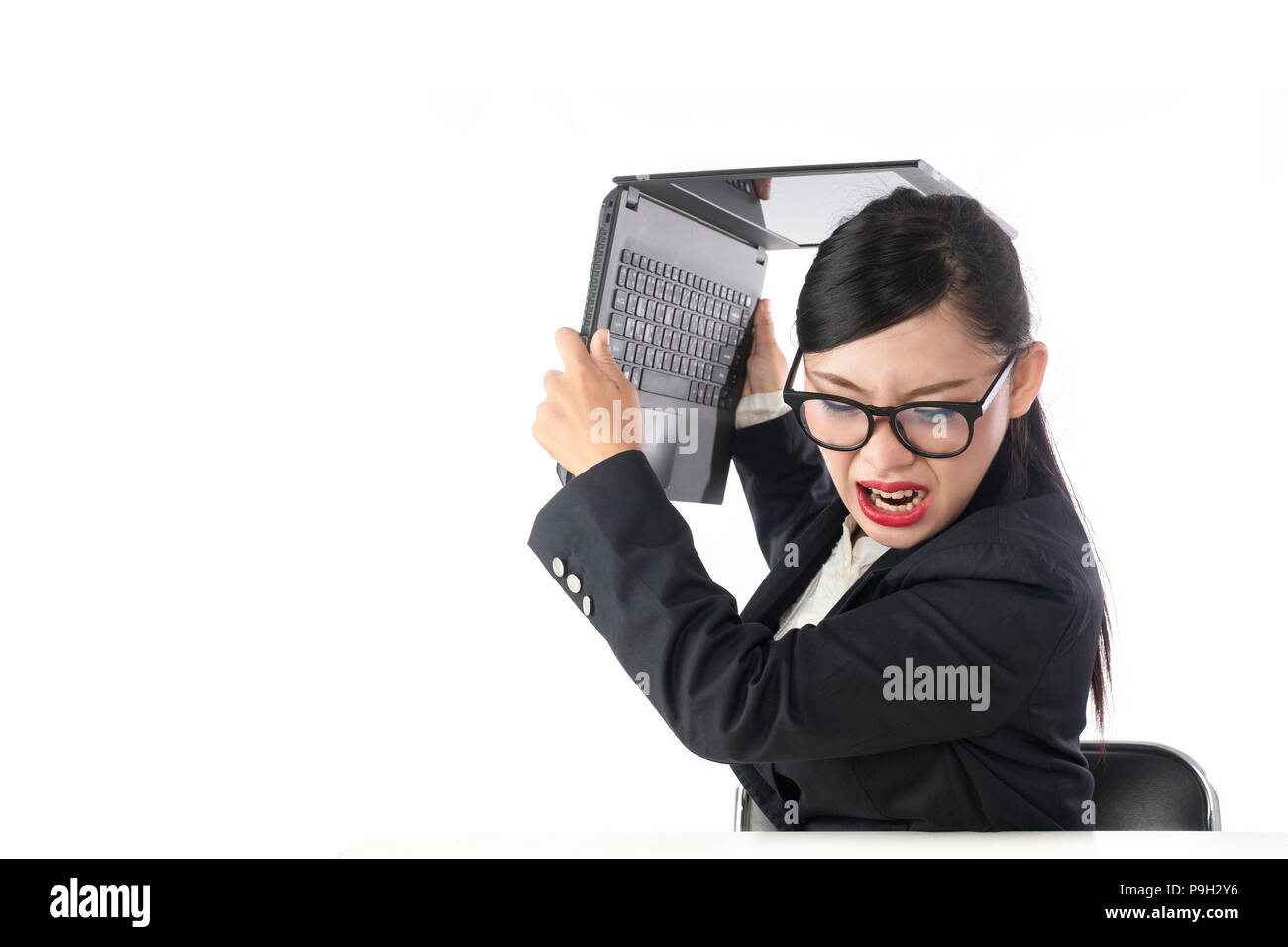 Stressful, Business woman is throwing a notebook on white background - Stock Image