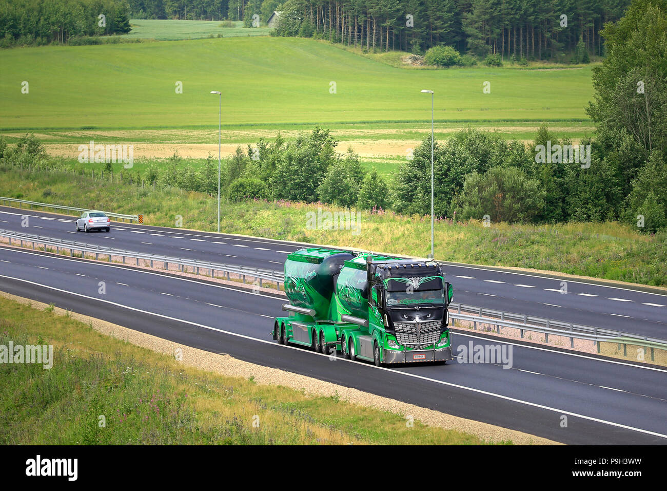 Mercedes-Benz Actros 2551 Highway Hero show truck and bulk transporter of Kuljetus Auvinen Oy on the road in summer. Salo, Finland - July 13, 2018. - Stock Image