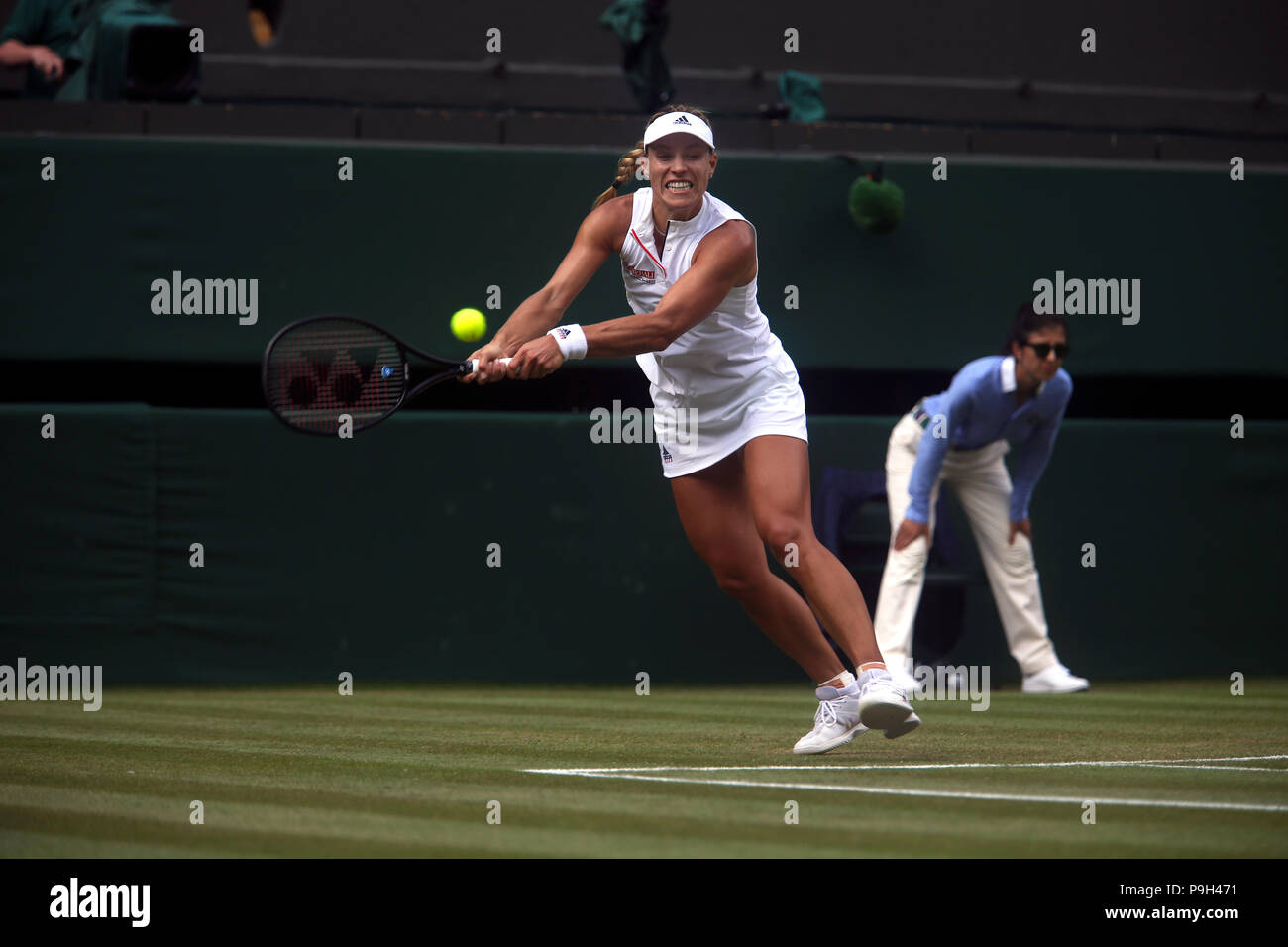 London, England - July 7, 2018.  Wimbledon Tennis: Germany's Angie Kerber strikes a backhand to her opponent Naomi Osaka of Japan during their third r - Stock Image