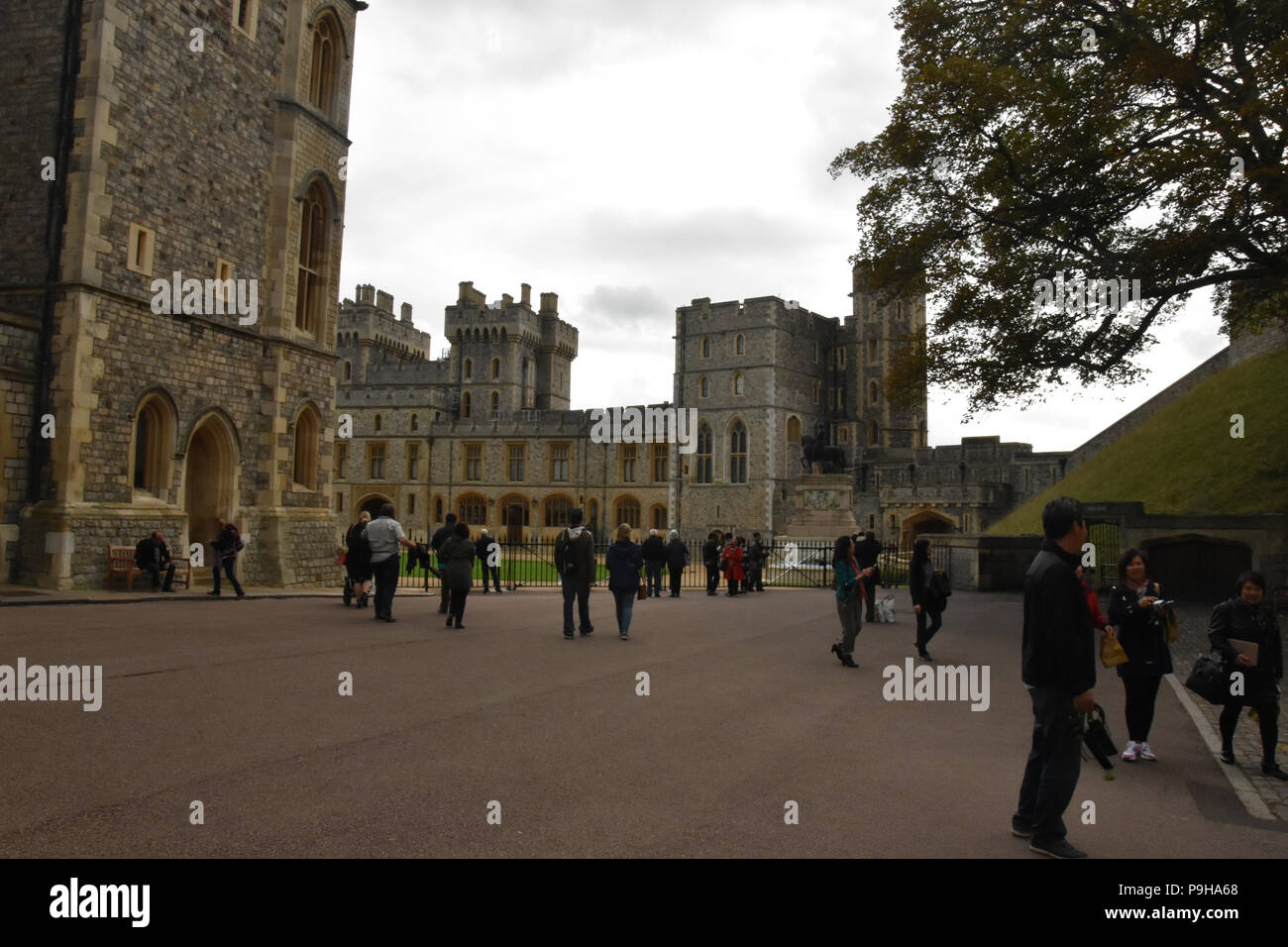 Tourists outside the State Apartments in the Middle Ward of Windsor Castle, Windsor, UK. - Stock Image
