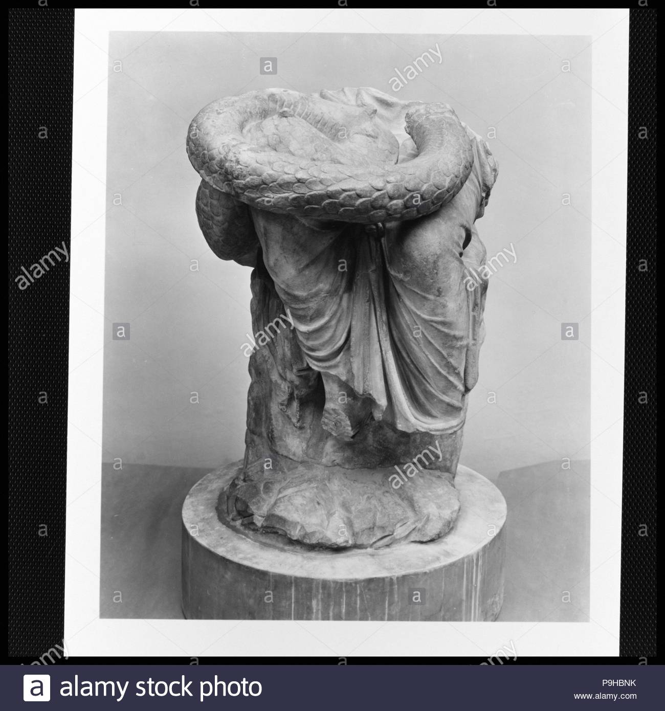 Lower part of a marble seated statue of Hygieia, Imperial, 1st or 2nd century A.D., Roman, Marble, H. 50 in. (127.0 cm), Stone Sculpture, Copy or adaptation of a Greek work of the 3rd or 2nd century B.C. Hygieia, the personification of Health, was the daughter of Asklepios, the god of healing. Snakes were closely associated with both figures and were actually kept in many of the sanctuaries where the sick gathered. - Stock Image