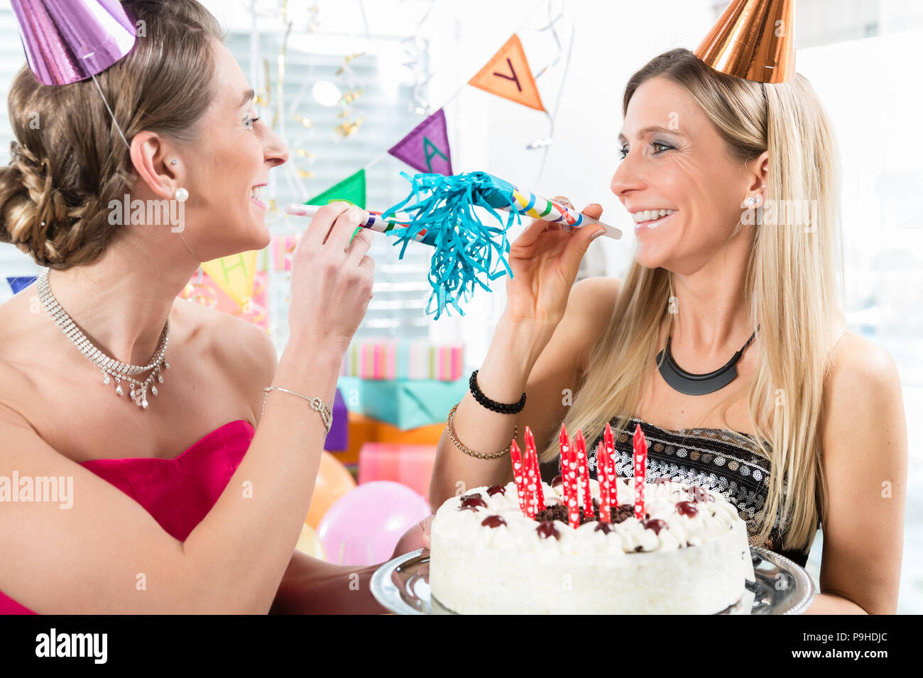 Fantastic Two Cheerful Women And Best Friends Holding A Birthday Cake Stock Personalised Birthday Cards Beptaeletsinfo