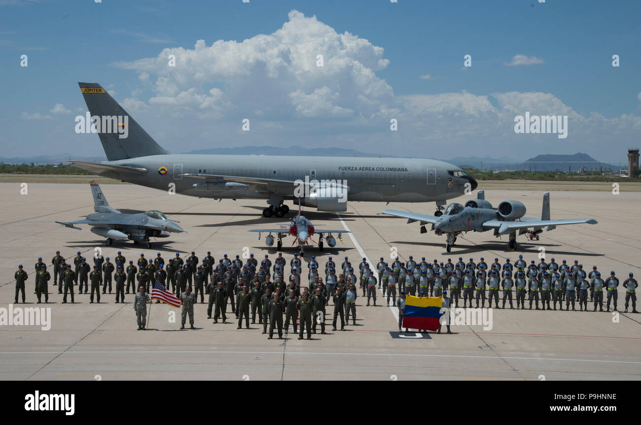 Airmen from the Colombian Air Force and U.S. Air Force pose for a group photo in front of a Colombian Air Force 767 Multi-Mission Tanker Transport Jupiter aircraft, a U.S. Air Force F-16 Fighting Falcon, a Colombian Air Force Kfir fighter jet and an U.S. Air Force A-10 Thunderbolt II on the flightline at Davis-Monthan Air Force Base, Ariz., July 13, 2018. Six Colombian Kfirs from the Combat Squadron No. 111, arrived to train with the 162nd Wing's F-16s and the 354th Fighter Squadron's A-10 Thunderbolt IIs in preparation for Red Flag 18-3.(U.S. Air Force photo by Staff Sgt. Angela Ruiz) Stock Photo