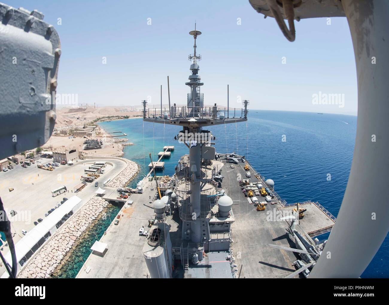 180709-N-ZG607-0097 AQABA, Jordan (July 9, 2018) The Wasp-class amphibious assault ship USS Iwo Jima (LHD 7) sits pier side Aqaba, Jordan. Iwo Jima is deployed to the U.S. 5th Fleet area of operations in support of naval operations to ensure maritime stability and security in the central region, connecting the Mediterranean and the Pacific through the western Indian Ocean and three strategic choke points. (U.S. Navy photo by Mass Communication Specialist 3rd Class Dominick A. Cremeans/Released) Stock Photo