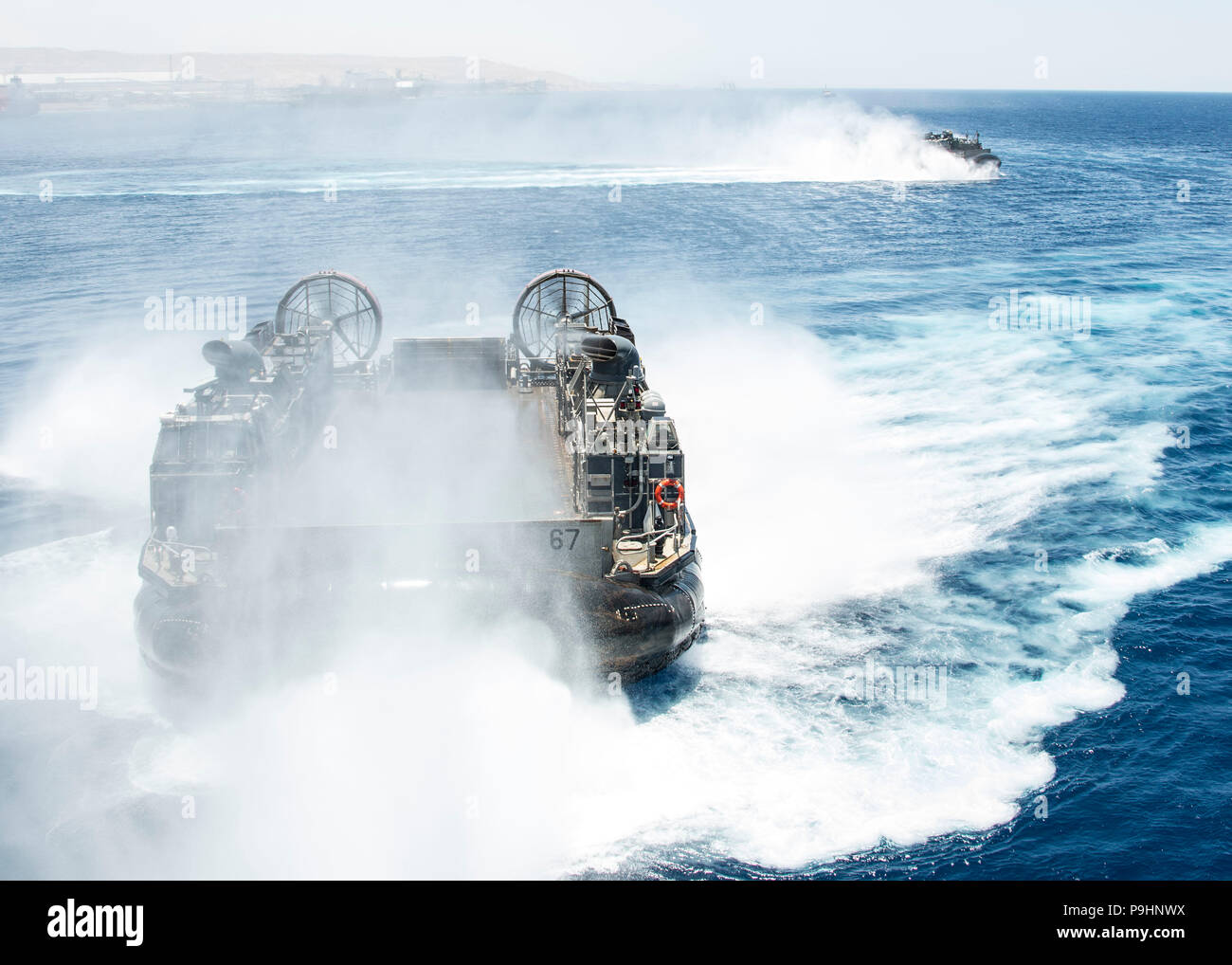 180705-N-ZG607-0195 AQABA, Jordan (July 5, 2018) A landing craft, air cushion, attached to Assault Craft Unit 4, approaches the Wasp-class amphibious assault ship USS Iwo Jima (LHD 7) during amphibious training. Iwo Jima is deployed to the U.S. 5th Fleet area of operations in support of naval operations to ensure maritime stability and security in the central region, connecting the Mediterranean and the Pacific through the western Indian Ocean and three strategic choke points. (U.S. Navy photo by Mass Communication Specialist 3rd Class Dominick A. Cremeans/Released) Stock Photo
