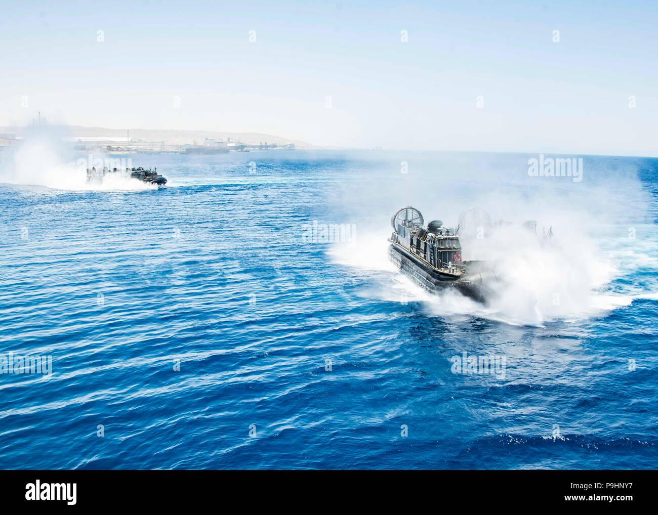 180705-N-ZG607-0187 AQABA, Jordan (July 5, 2018) A landing craft, air cushion, attached to Assault Craft Unit 4, approaches the Wasp-class amphibious assault ship USS Iwo Jima (LHD 7) during amphibious training. Iwo Jima is deployed to the U.S. 5th Fleet area of operations in support of naval operations to ensure maritime stability and security in the central region, connecting the Mediterranean and the Pacific through the western Indian Ocean and three strategic choke points. (U.S. Navy photo by Mass Communication Specialist 3rd Class Dominick A. Cremeans/Released) Stock Photo