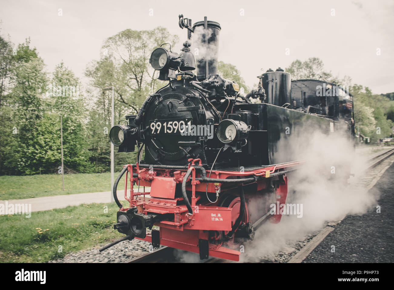 Old Steam Train driving in station - Stock Image