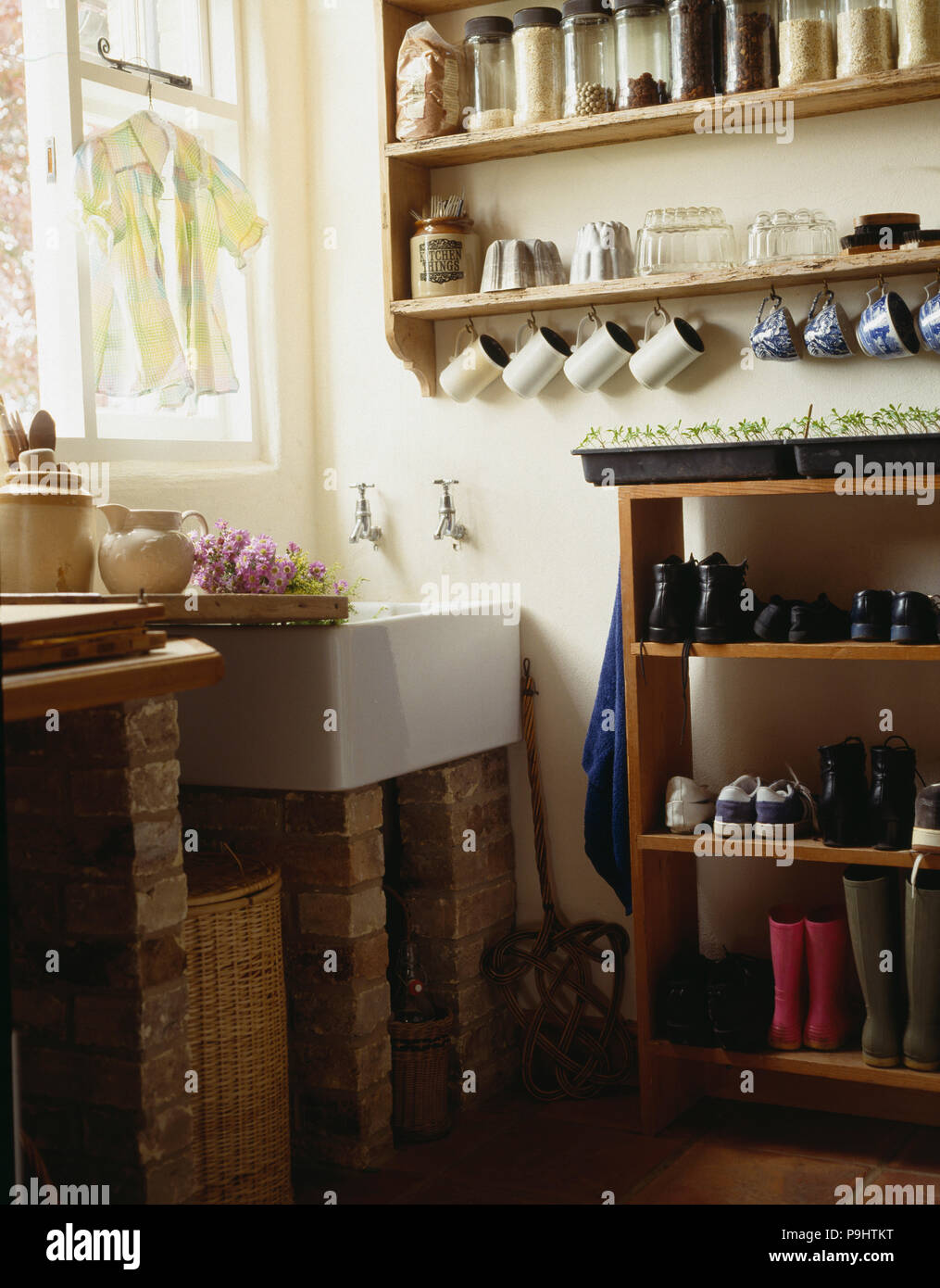 Super Storage Jars On Shelves Above White Sink In Rustic Utility Home Interior And Landscaping Oversignezvosmurscom