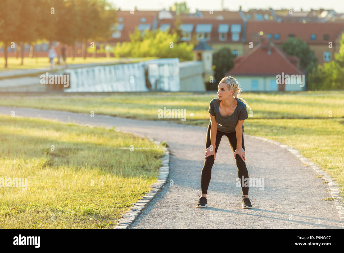 Blond Woman Running In The Park - Stock Photo