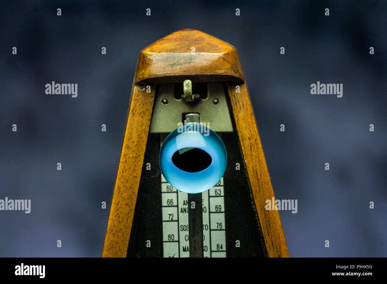 evil eye contained within the  triangle of a metronome. - Stock Image