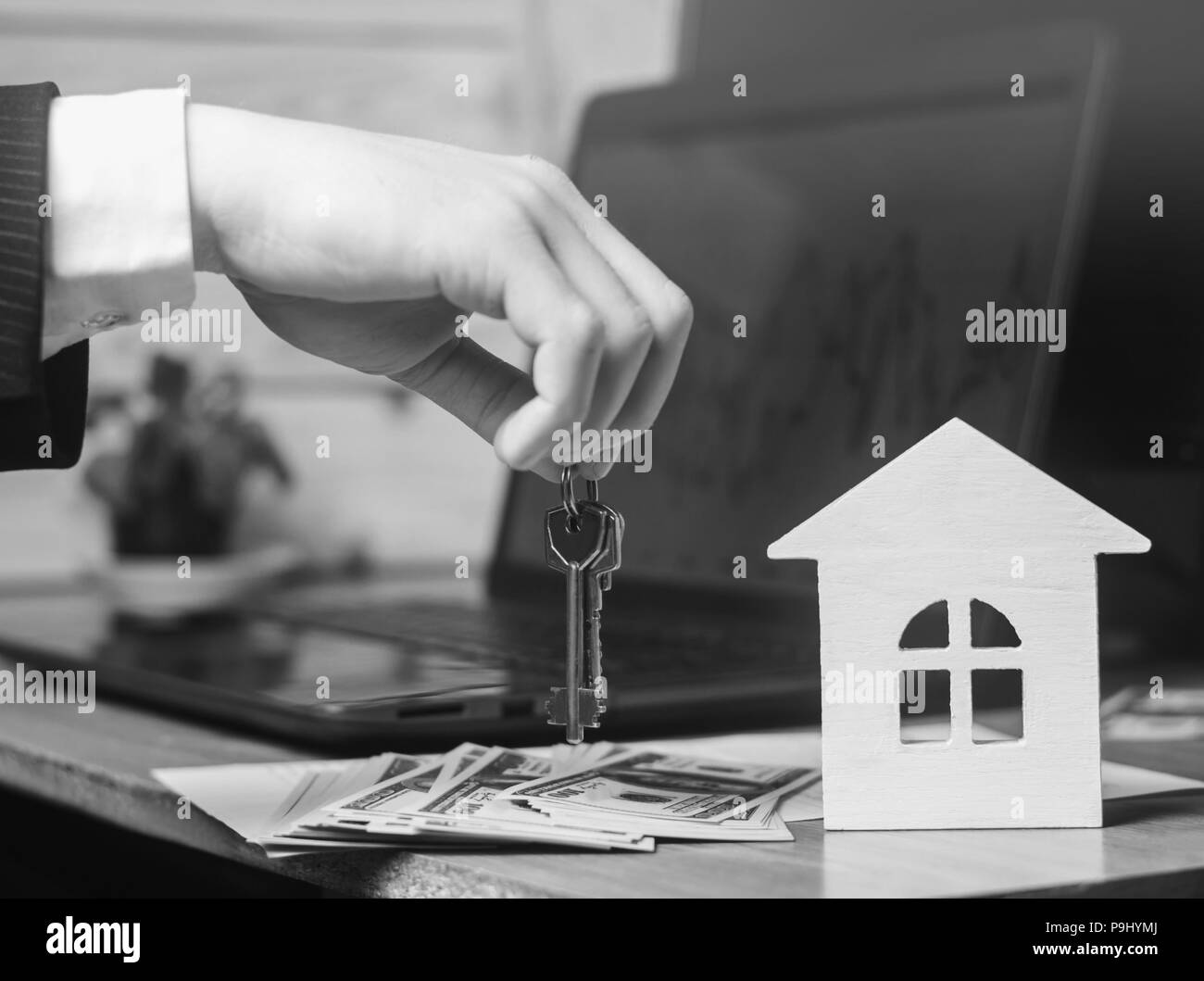The hand holds the keys to the house. concept of real estate. sale or rental of housing, apartment rental. realtor - Stock Image
