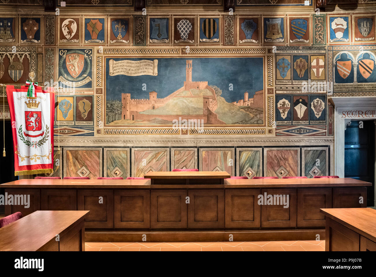 San Miniato, Tuscany - the 14c Palazzo Comunale (town hall). The Council Chamber was frescoed in 1928 in medieval style with scenes from local history - Stock Image