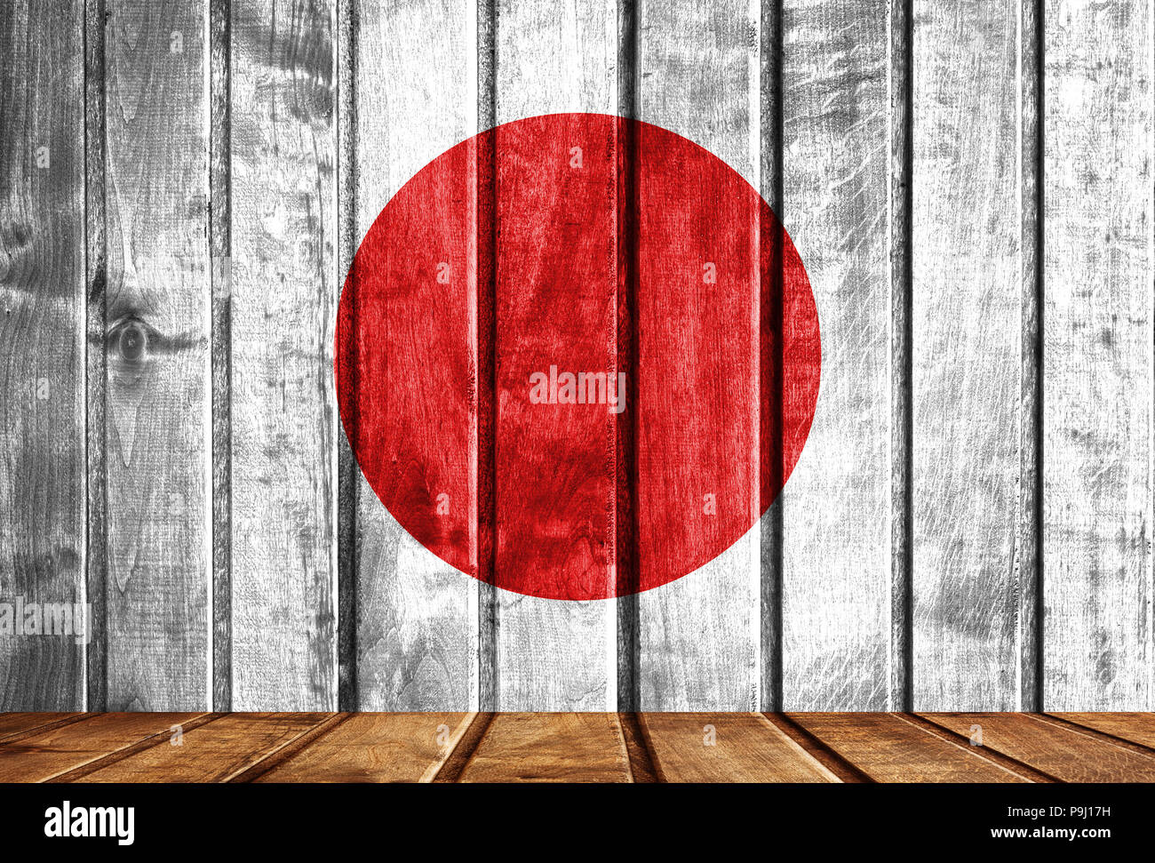 Wooden background with a flag of Japan. There is a place for your text in the photo. Stock Photo