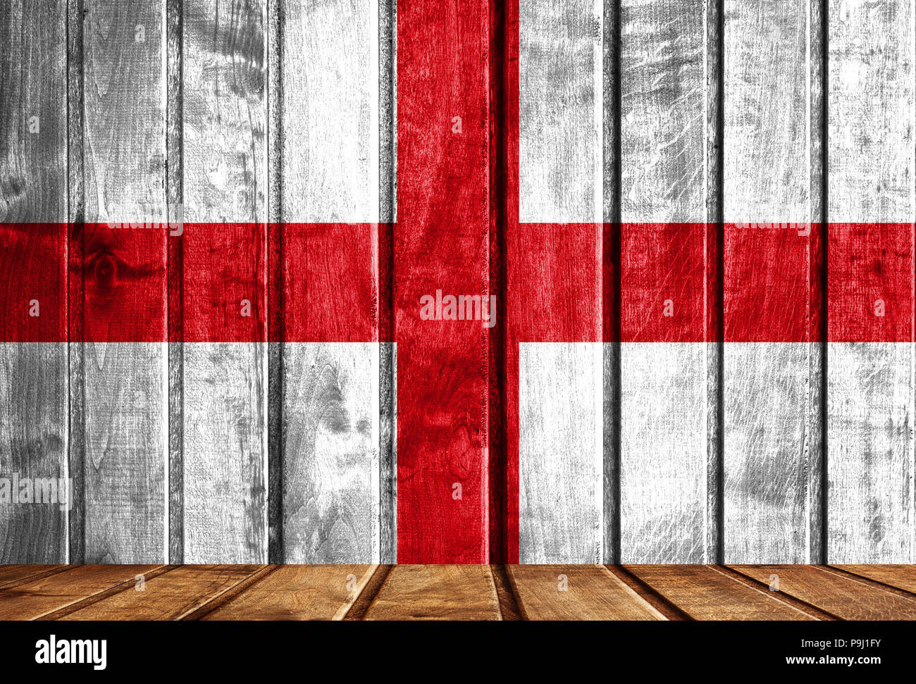 Wooden background with a flag of England. There is a place for your text in the photo. Stock Photo