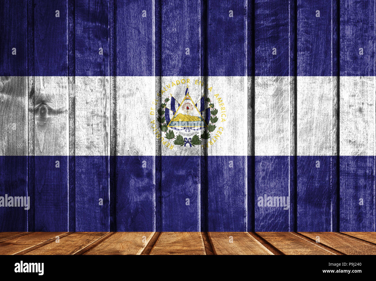 Wooden background with a flag of El Salvador. - Stock Image