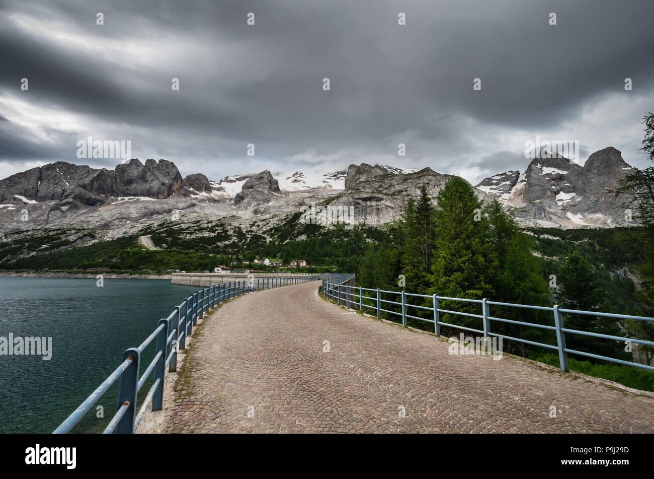Lago Fedaia - Fedaia Lake, Dolomiti mountain Italy. Marmolada massif in Trentino Alto Adige, South Tyrol italian Dolomites - Stock Image