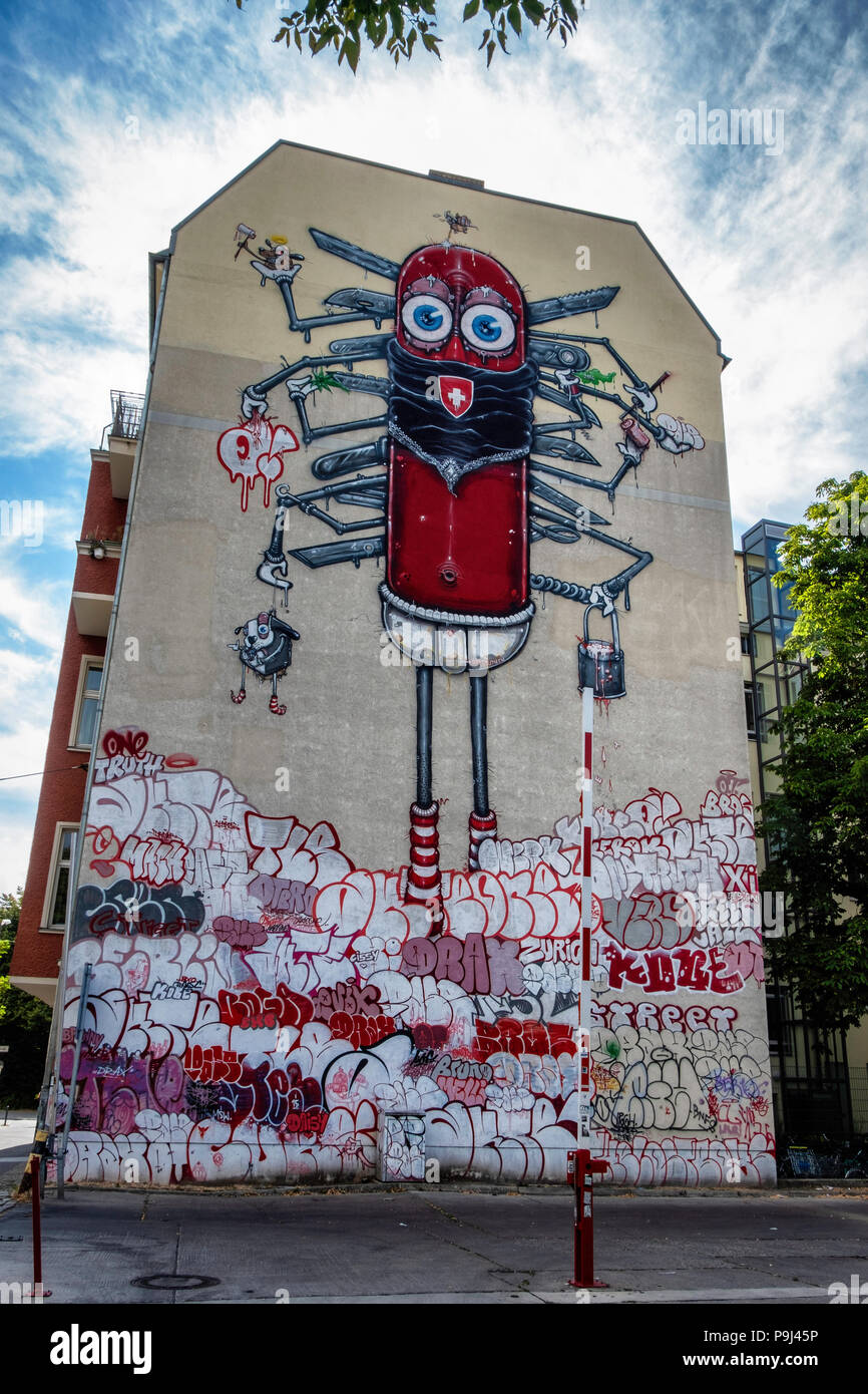 Berlin-Friedrichshain, Artwork 'Swiss made' by the One Truth Brothers Pase and Dr.Drax. A big swiss army knife standing in a pile of tags - Stock Image