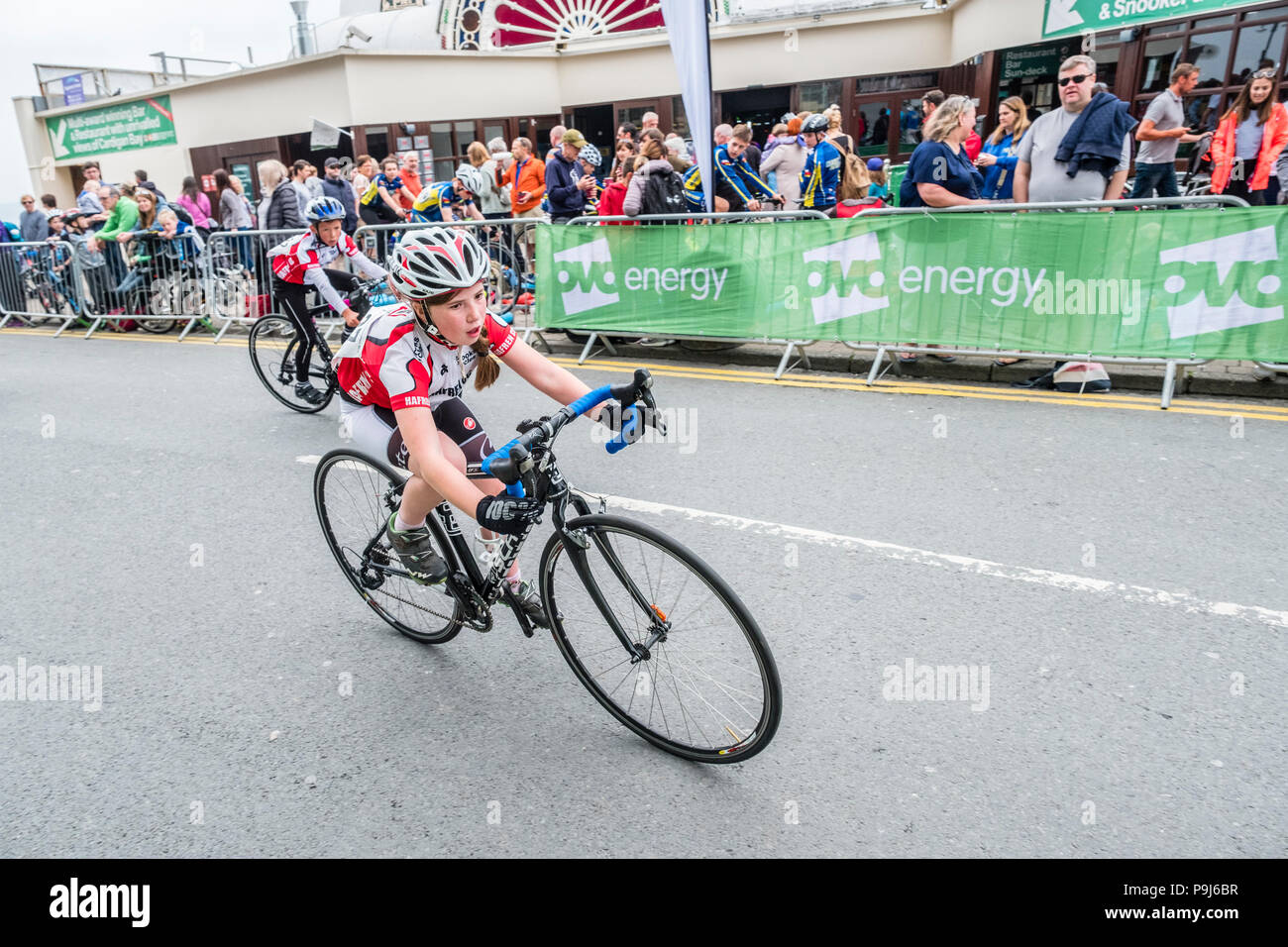 Cycling in the UK: Children and young people competing in a series of street races around Aberystwyth  Wales UK as part of  the annual Aber Cycle Fest event,  a festival of road and off road cycling held in the town every May. - Stock Image