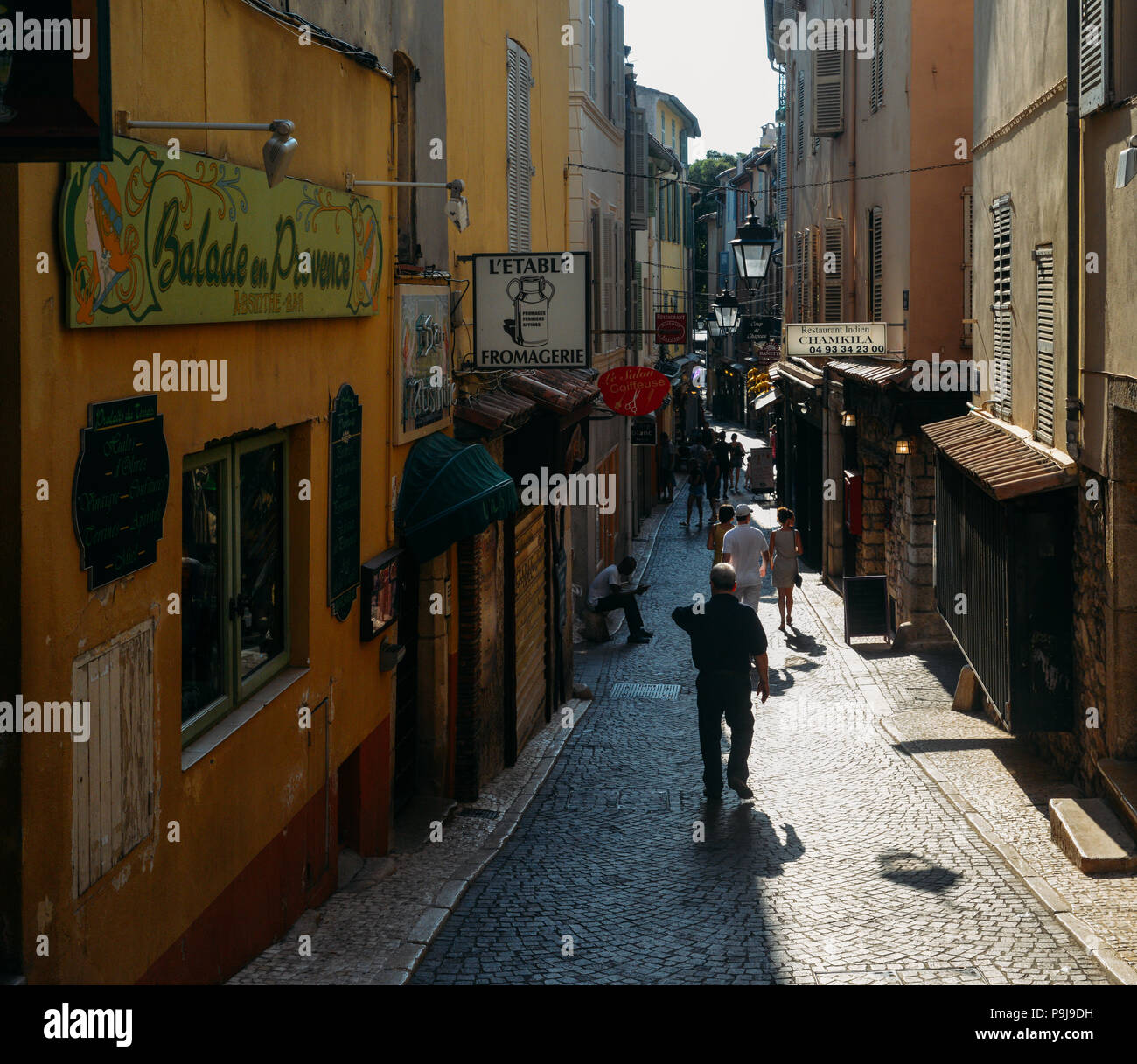 Narrow tourist street in Antibes, France. Antibes is a popular seaside town in the heart of the Cote d'Azur Stock Photo