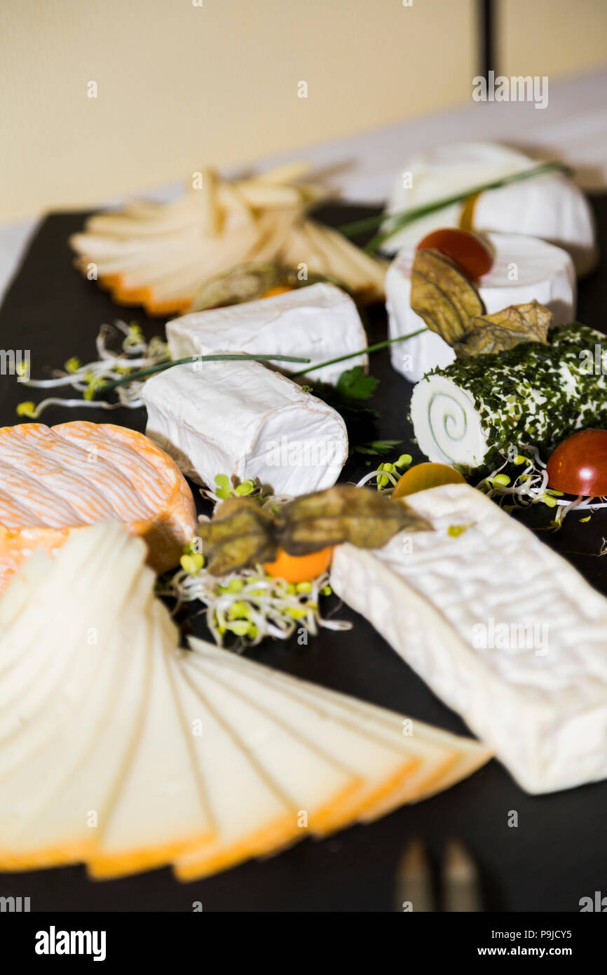 Cheese appetizing set on wooden board - Stock Image