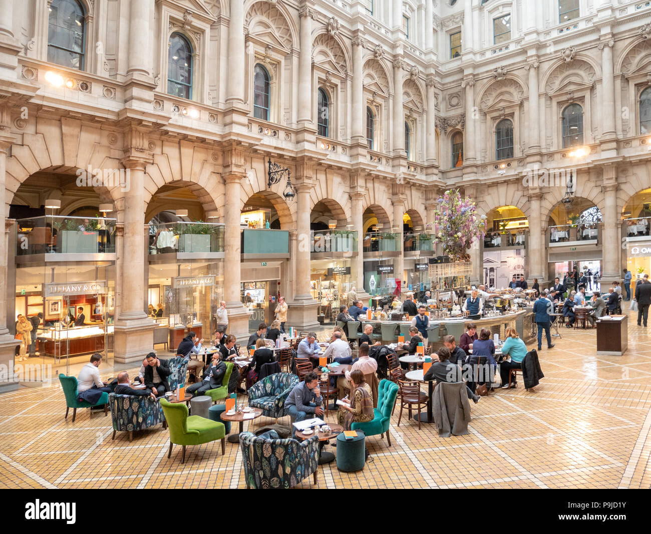 Shops, restaurants and bars in the Royal Exchange, City of London, UK - Stock Image