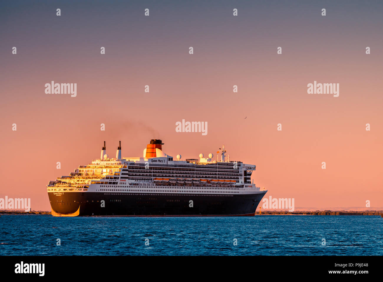 Adelaide, Australia - February 16, 2018: Cunard Line RMS Queen Mary 2 with people on board departing for a cruise from Outer Harbour, Port Adelaide Stock Photo