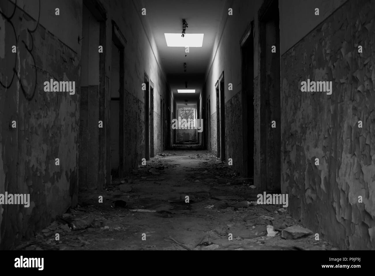 Interior of an abandoned building in black and white - Stock Image