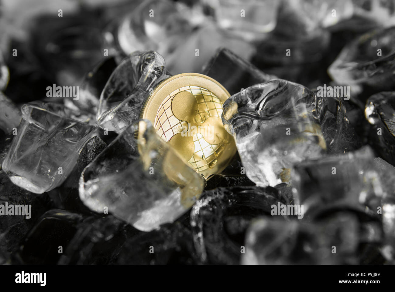 Gold ripple coin on ice background. The concept of the exchange in winter. Freeze. Blockchain mining. Digital money and virtual cryptocurrency concept. Iinvestment. Bussiness, commercial. - Stock Image