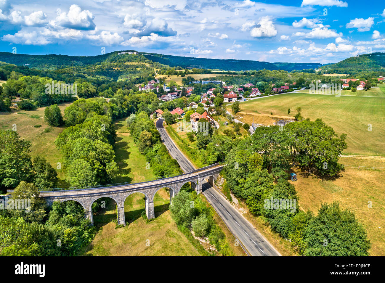 Aerial view of an old railway viaduct in Cleron, a village in France - Stock Image
