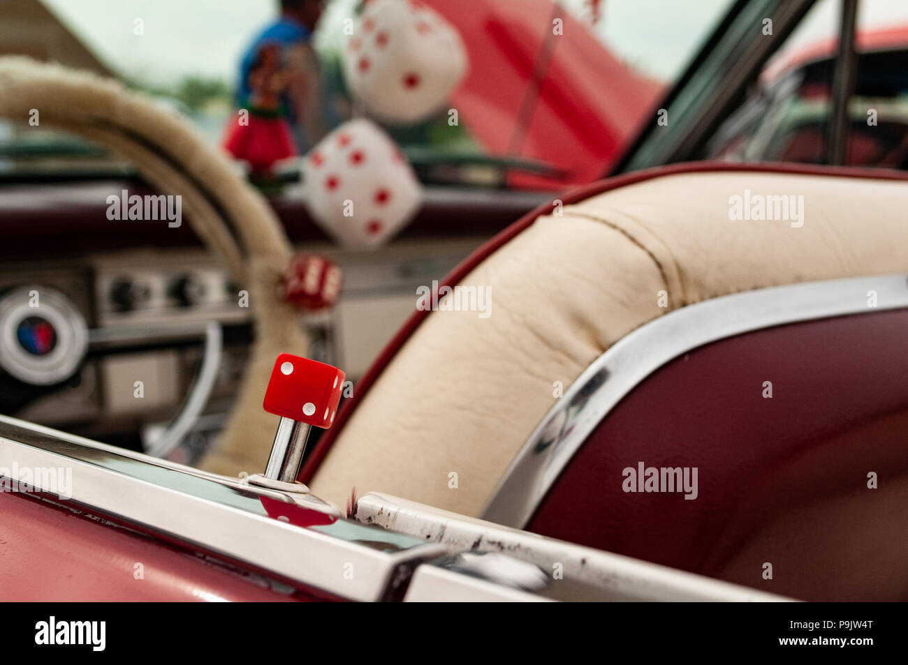 Classic convertibles at a car show in California with custom upholstery and fuzzy dice. - Stock Image