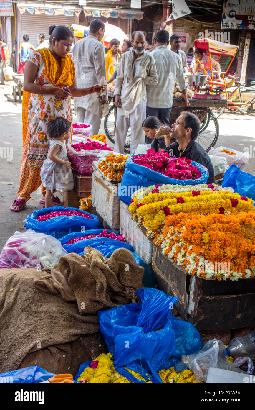 Indian woman and small girl visiting a flower market in Old Delhi, Delhi, India - Stock Image
