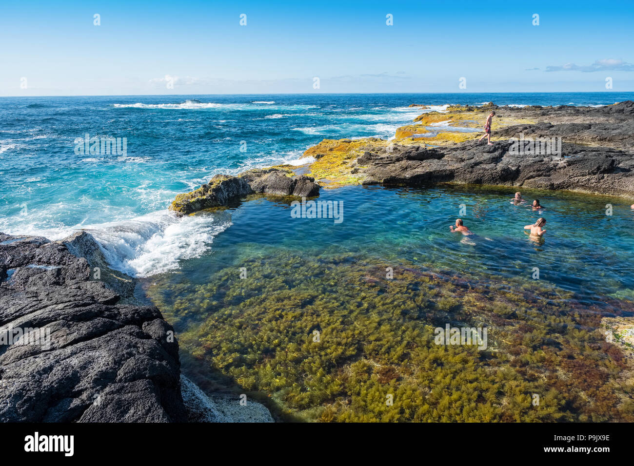 Natural swimming pools on the coast of Sao Miguel, Azores - Stock Image