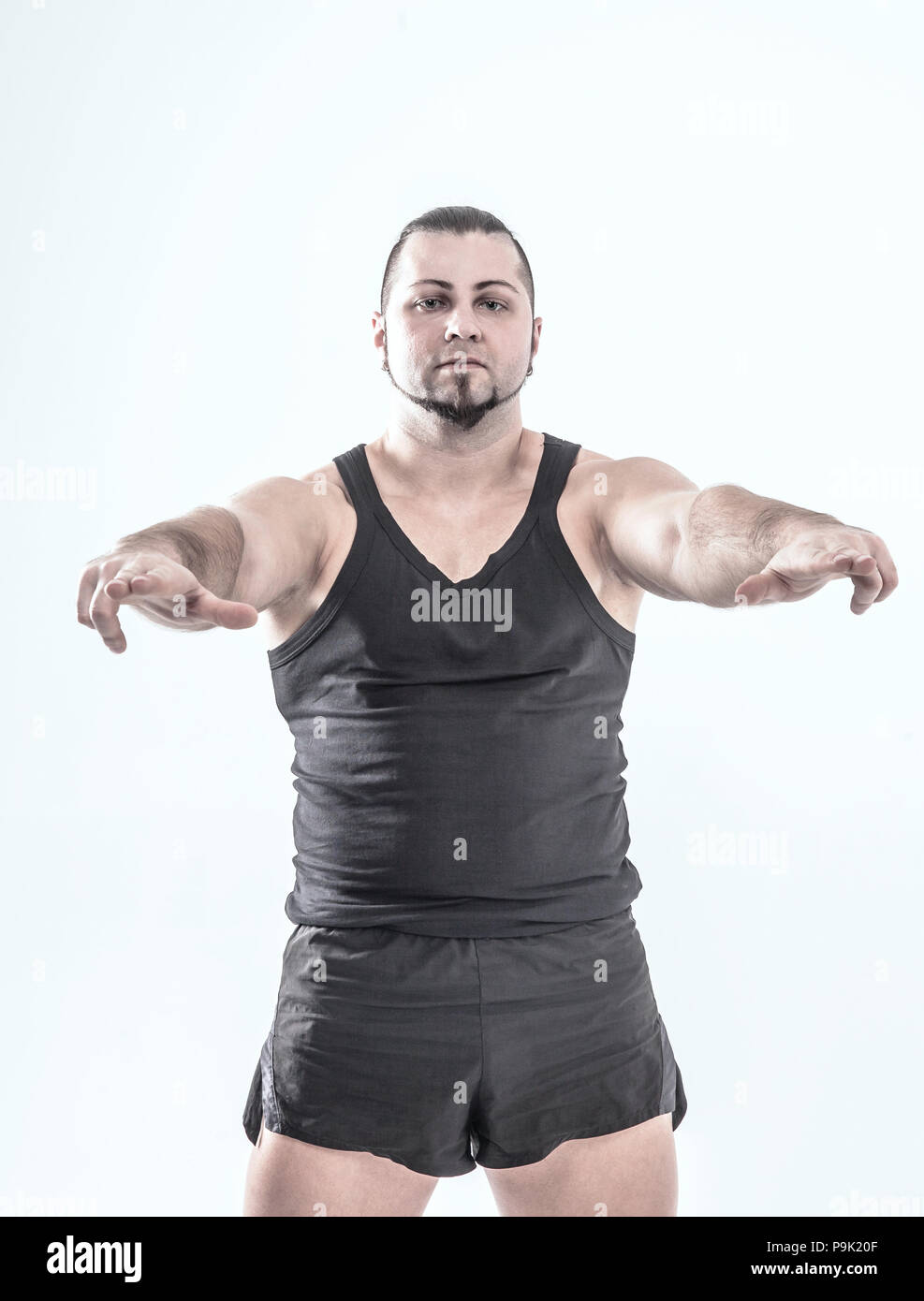 portrait - the trainer on bodybuilding on a white background. - Stock Image