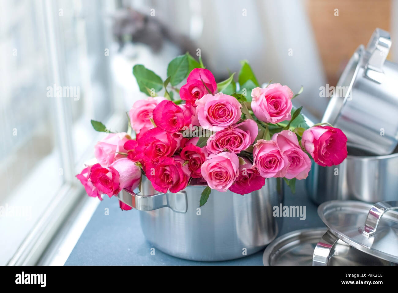 Pink roses cat stock photos pink roses cat stock images alamy a bouquet of fresh pink roses in a saucepan made of steel on a mightylinksfo