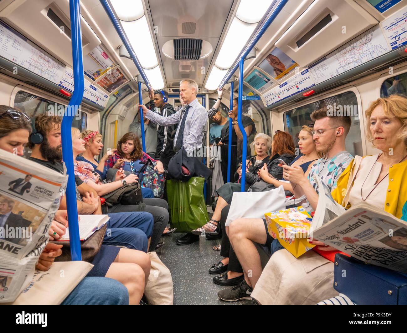 Crowded London Underground carriage, UK - Stock Image