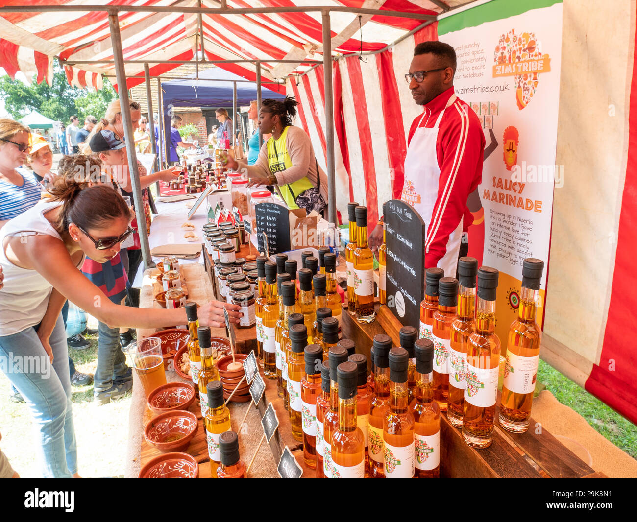 Stall selling specialty oils and marinades at a farmers market in Forty Hall, Enfield, London, UK - Stock Image