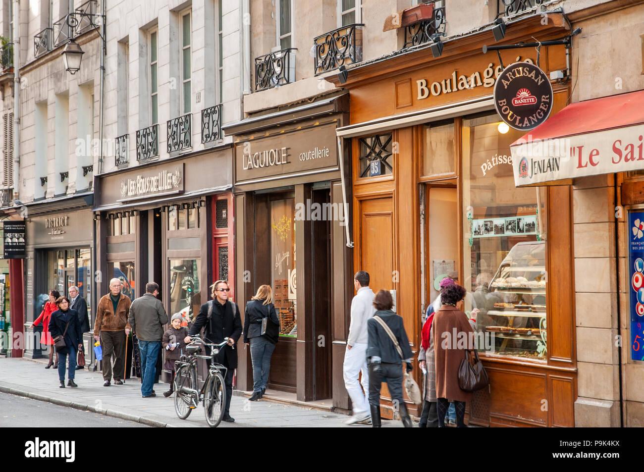 Row of small shops on the Rue des Deux Ponts on the Ile Saint-Louis, Paris, France - Stock Image