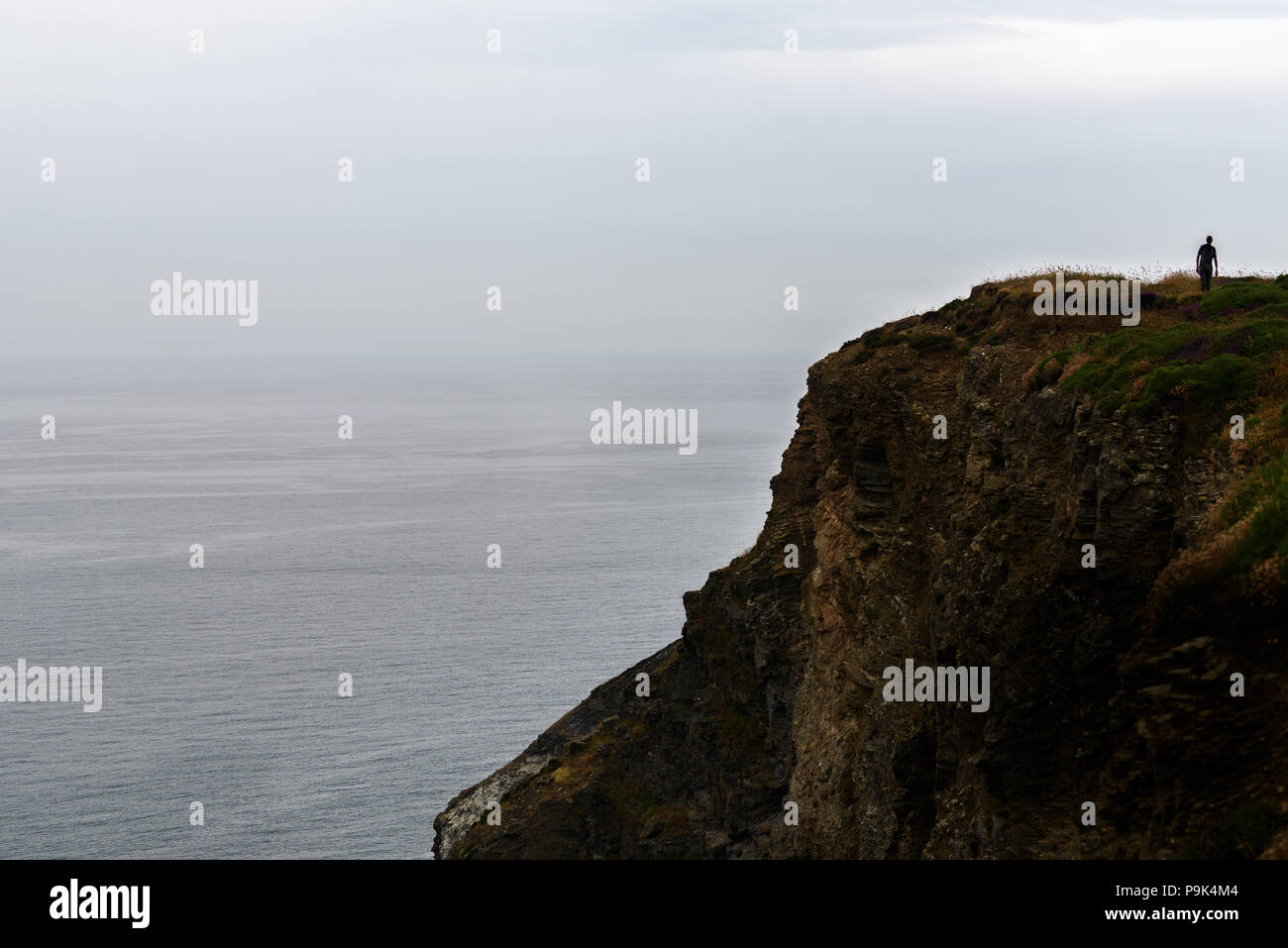Atlantic ocean on a calm day as seen from the South West Coast path in Cornwall, England - Stock Image