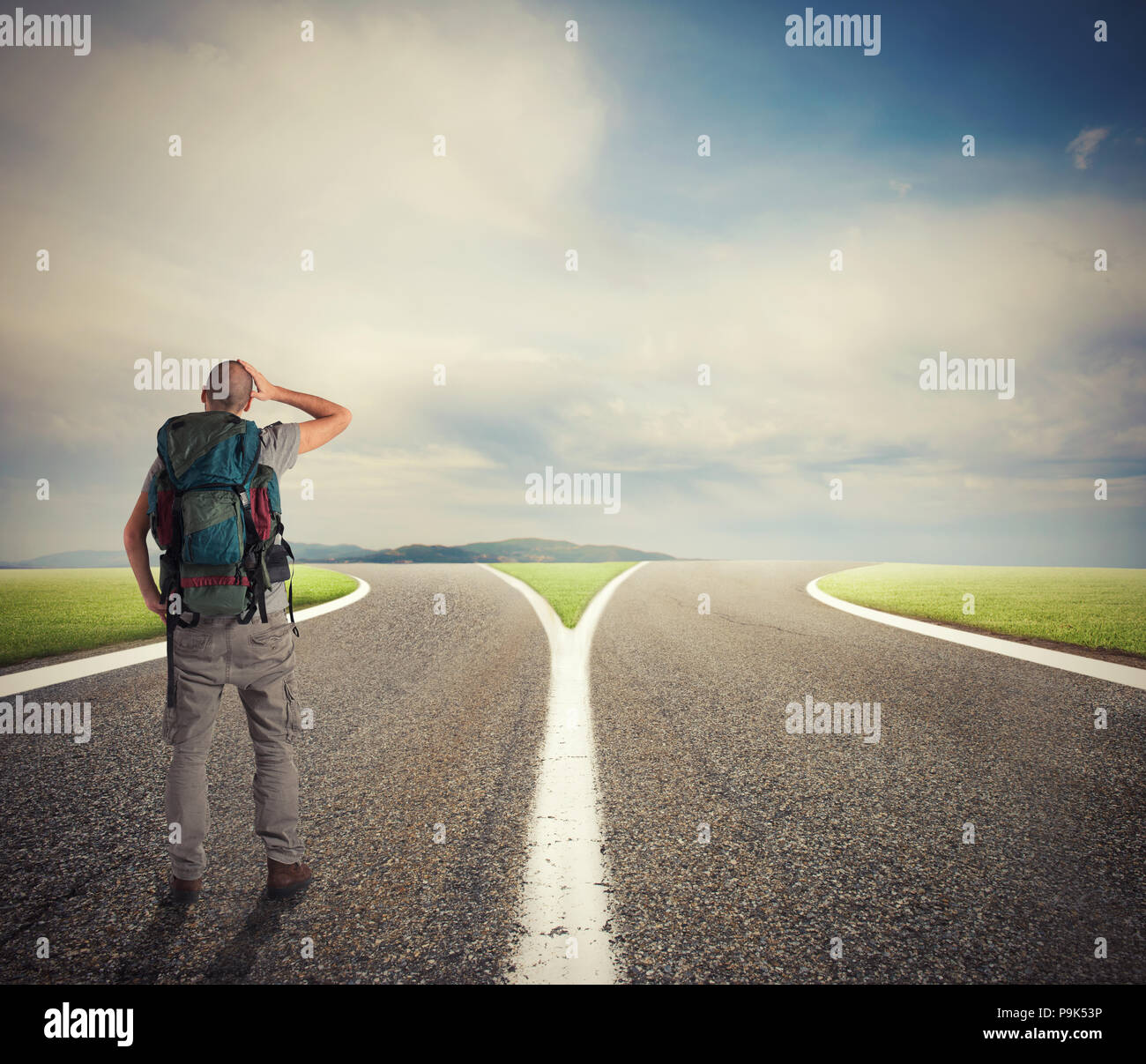 Businessman in front of a crossway must select the right way - Stock Image