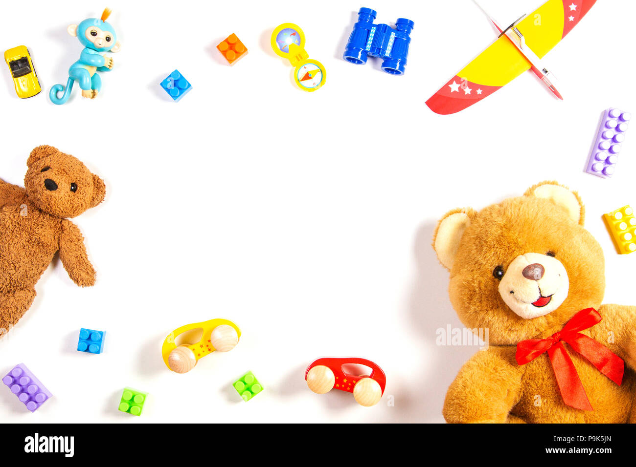 Colorful kids toys frame on white background. Top view, flat lay ...