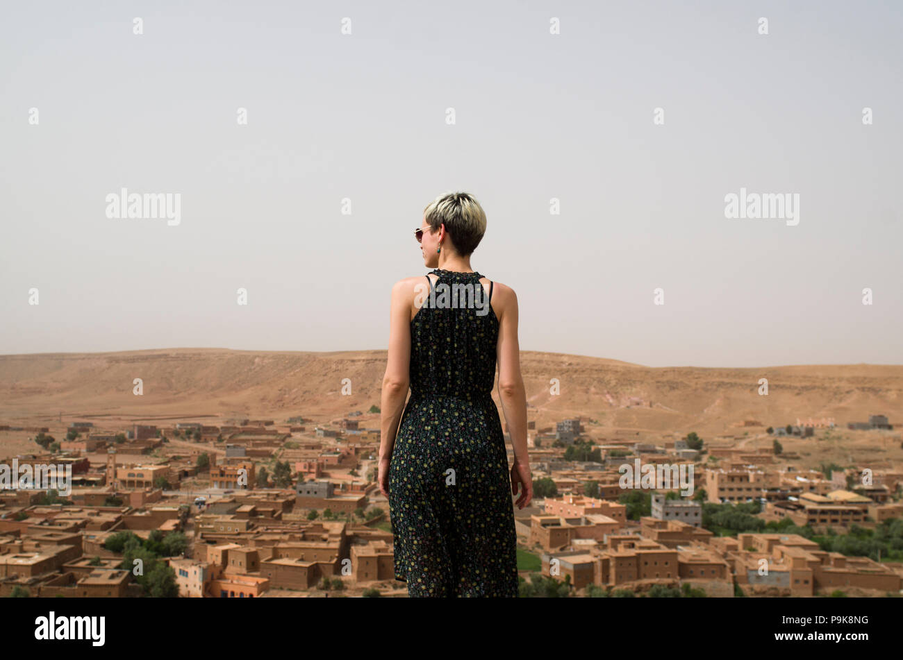 Woman standing above a village, morocco - Stock Image