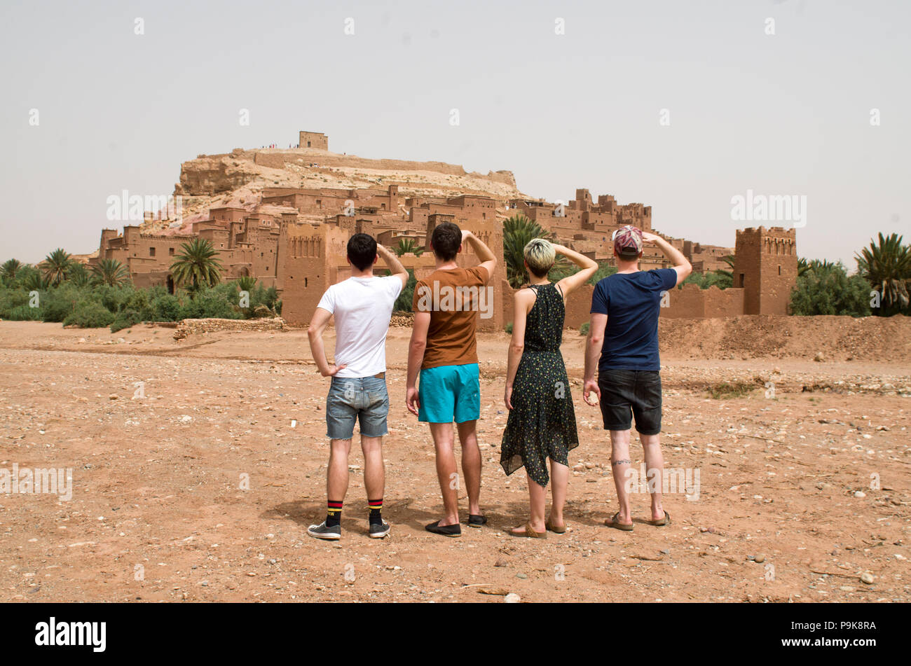 4 friends watching at a film sight, morocco - Stock Image
