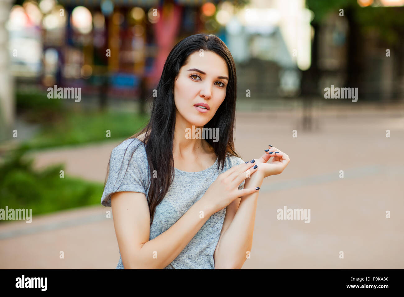 thoughtfull woman in the street - Stock Image