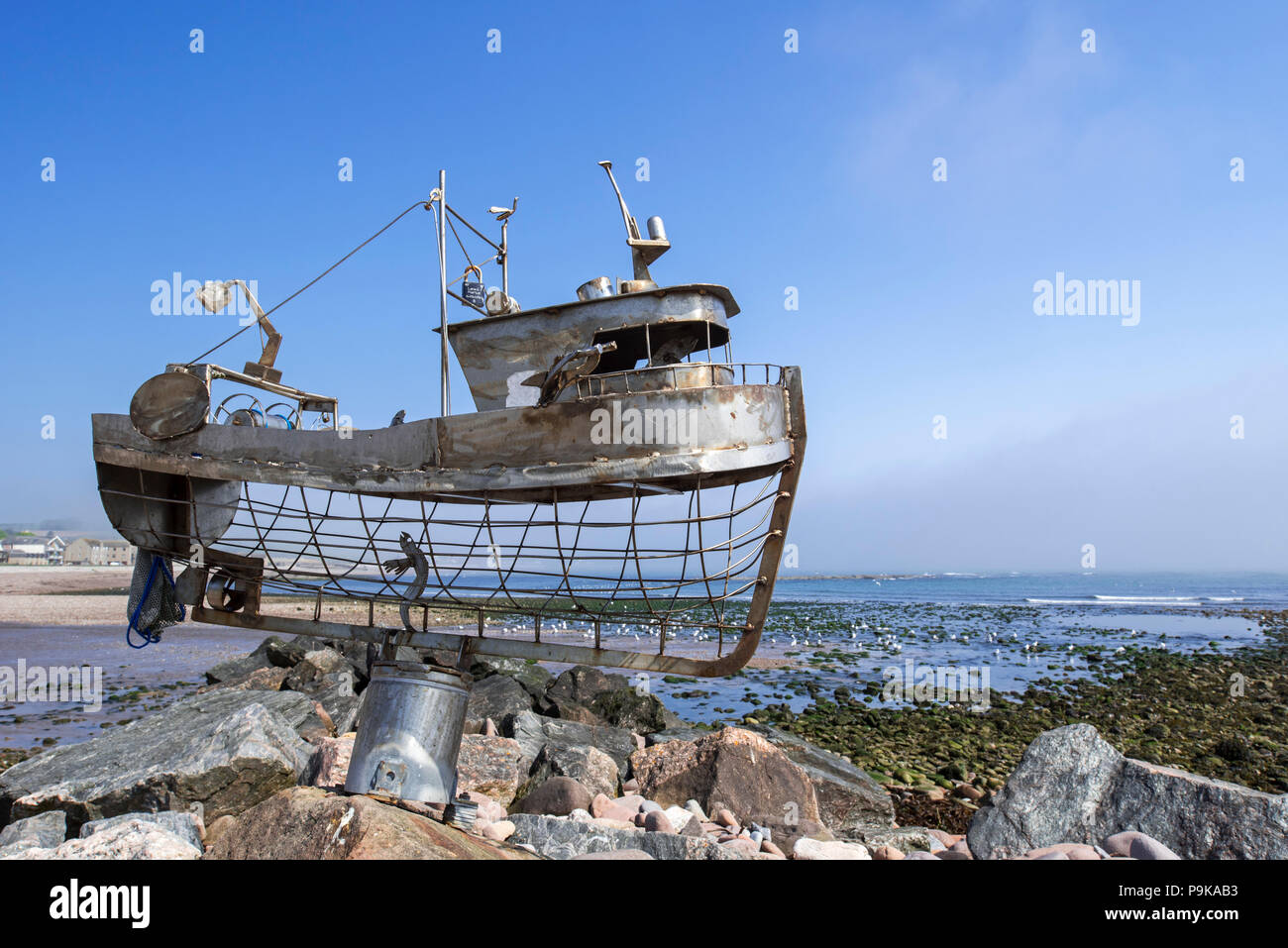 Metal sculpture of fishing boat along the waterfront at Stonehaven, Aberdeenshire, Scotland, UK - Stock Image