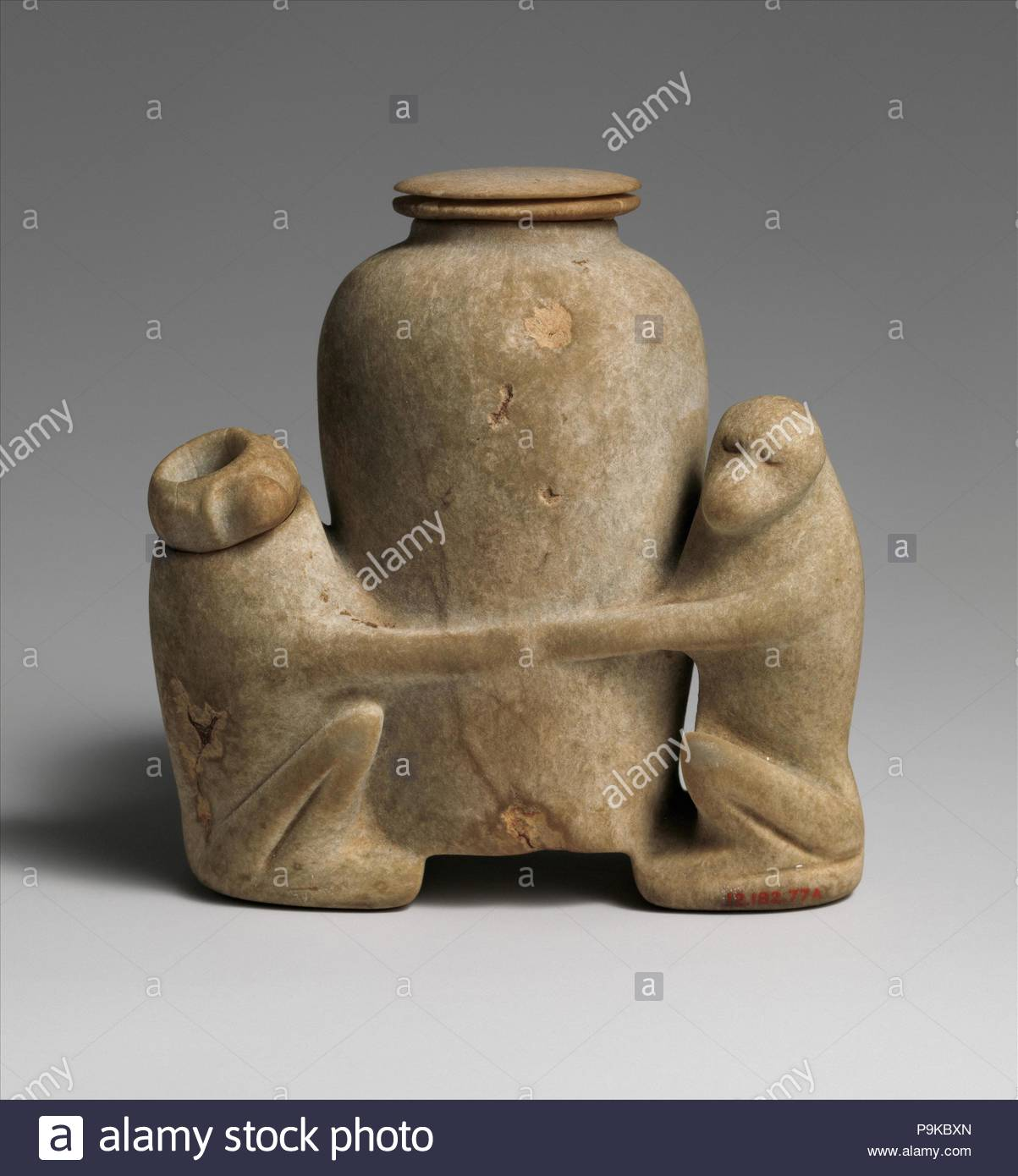 Ointment vessel in the shape of two baboons holding a jar, Middle Kingdom, Dynasty 13–17, ca. 1800–1550 B.C., From Egypt; Said to be from Northern Upper Egypt, Girga (Thinis), Anhydrite, h. 9.8 cm (3 7/8 in). - Stock Image
